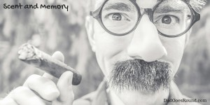 """Image of a man holding a cigar with text """"Scent and memory"""""""