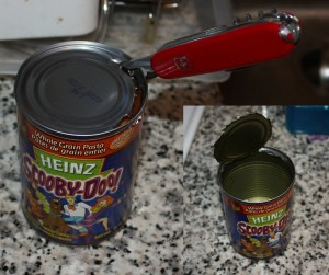 Image of a can opened with a swiss army knife