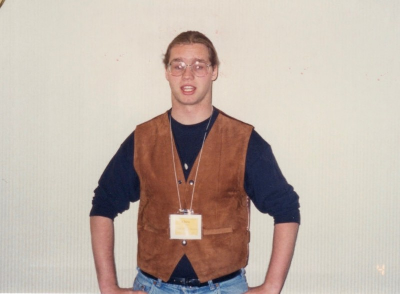 Image of the author as a teen with a ponytail and a very nice brown leather vest...