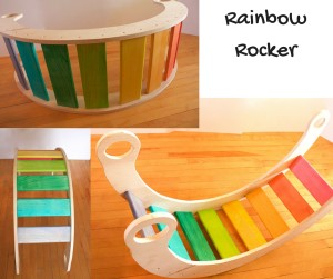 Image of a rocker for kids with rainbow coloured wooden slats to sit on