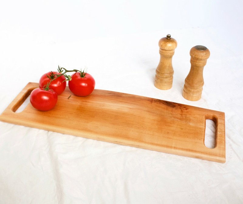 Image of a two-handled cherry bread board