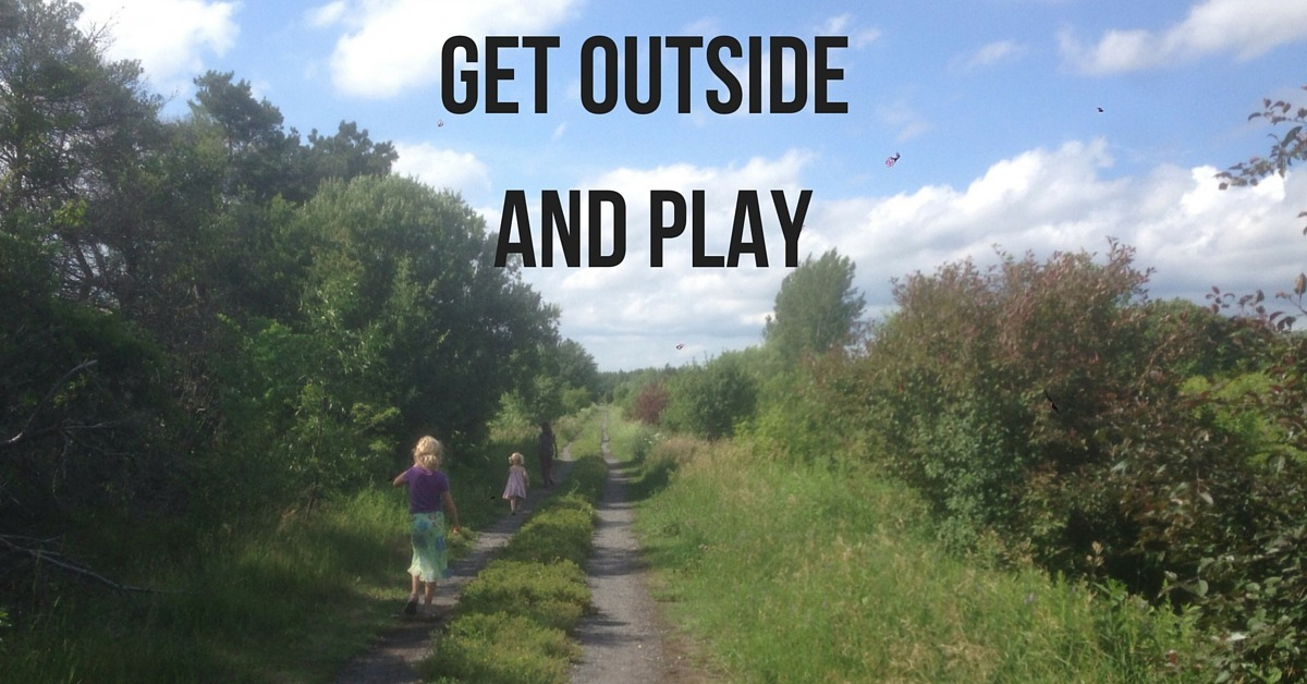 """Image of three kids walking a farm road with text """"Get Outside and Play"""""""