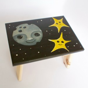 Image of a step stool with the moon and stars painted on it.