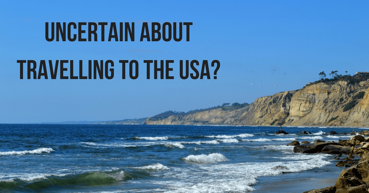 """Image of the San Diego coast with text """"uncertain about travelling to the USA?"""""""