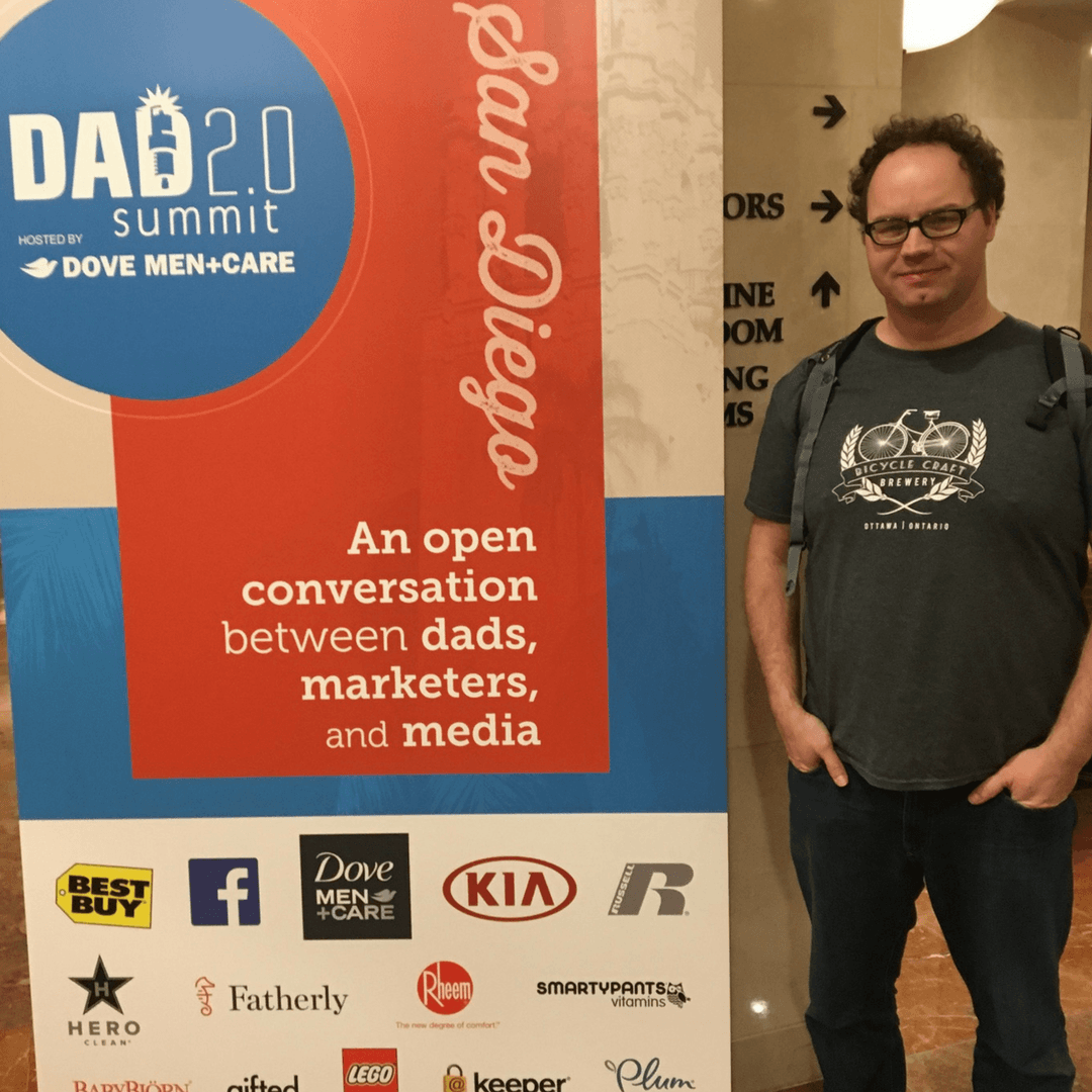 Dadblogger with the sign for Dad 2.0 Conference