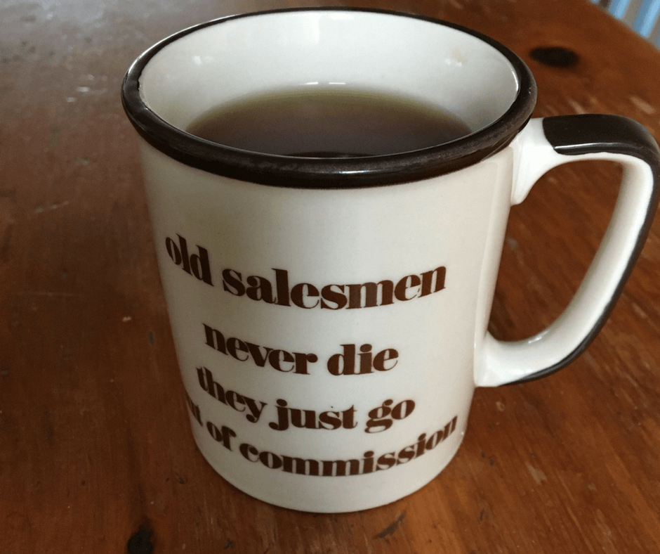 """image of a mug with saying """"Old salesmen never die, they just go out of commission."""""""