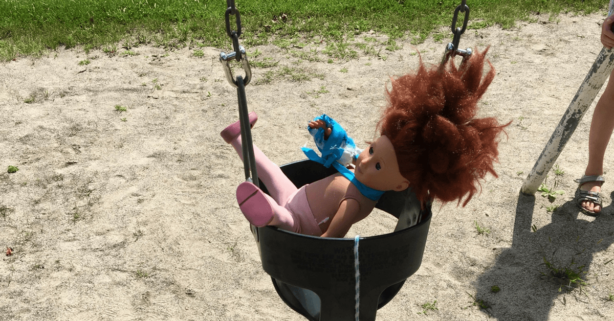 Image of a doll in a swing